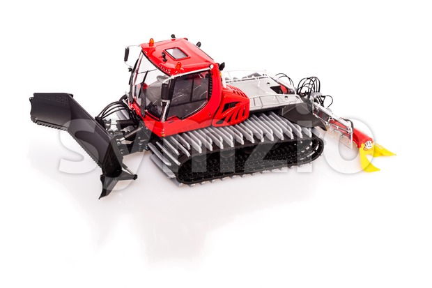 Very detailed toy model of a now-grooming machine or snowcat with reflection and shadow on white background