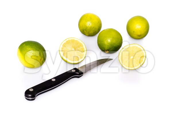 Knife and green fresh limes Stock Photo