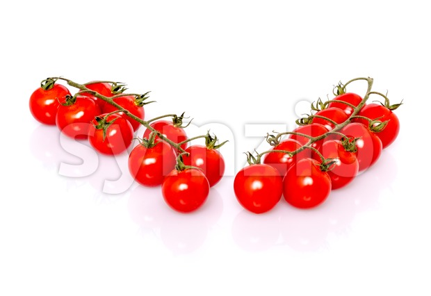 Fresh ripe cherry tomatoes on white background Stock Photo