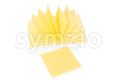 Blank yellow sticky note and block on white Stock Photo