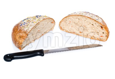 Two half loafs of bread with knife Stock Photo