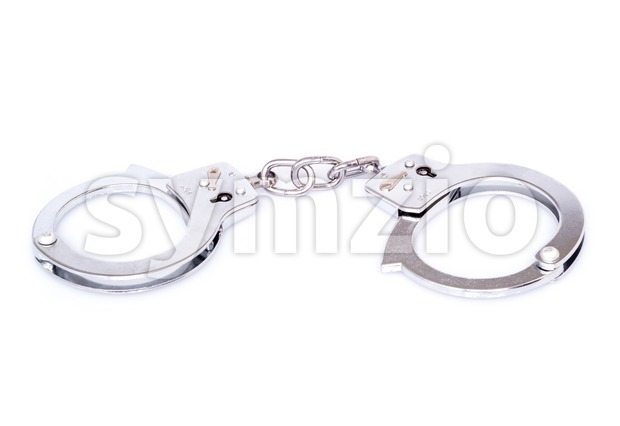 Closed handcuffs on white background Stock Photo