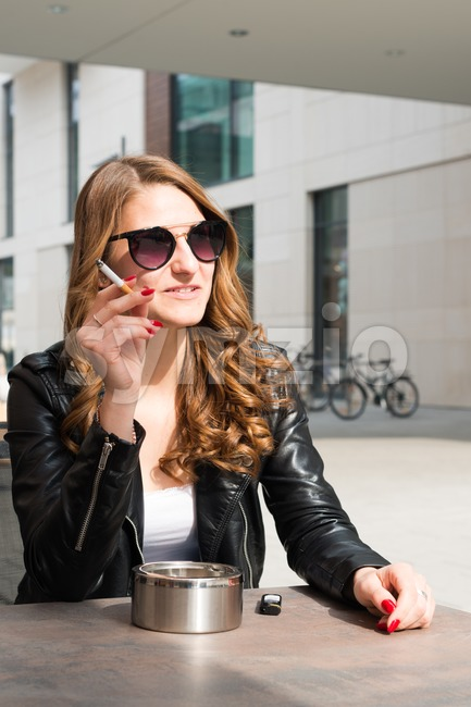 Young woman smoking a cigarette Stock Photo