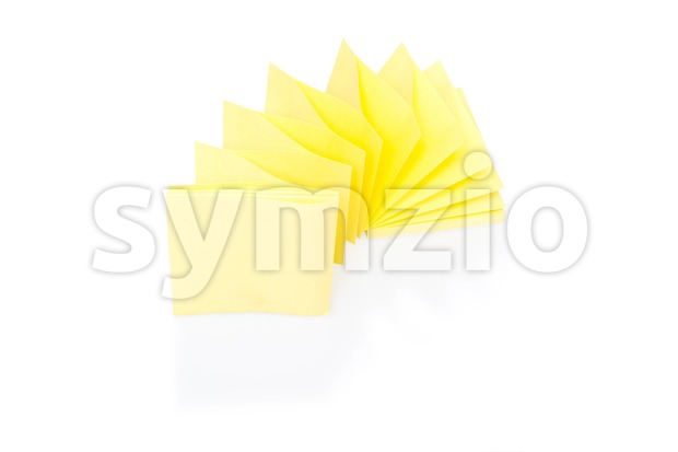 Blank yellow sticky note on block with shadow and reflection on white background