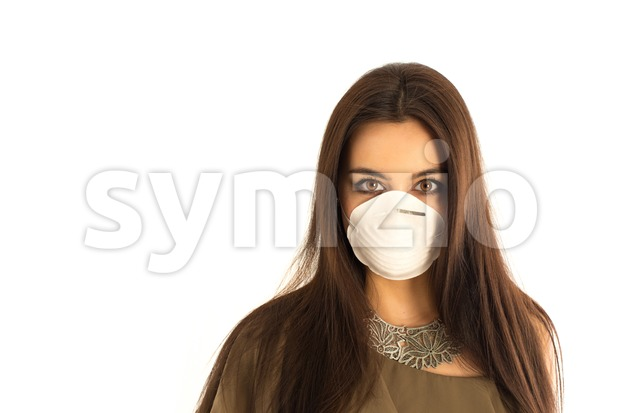Attractive woman wearing a protective mask Stock Photo