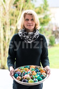 woman presenting easter eggs Stock Photo