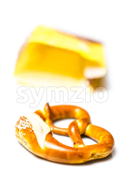 Fresh German pretzel  out of its paper bag on white Stock Photo