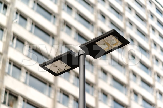 Modern streetlamp and concrete building Stock Photo