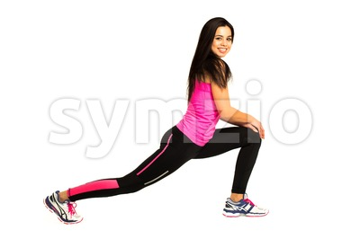 Young woman stretching her legs Stock Photo