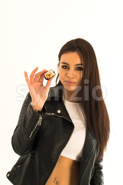 Attractive young woman holding sushi in her hand Stock Photo