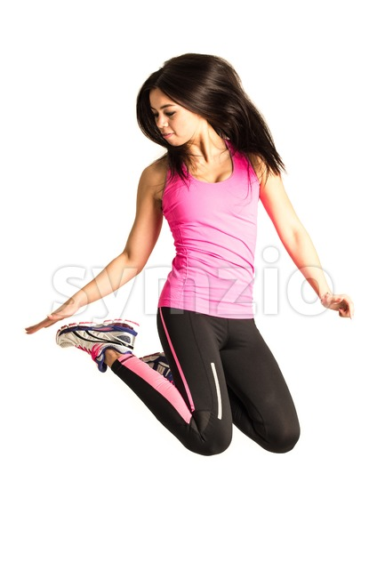Sportive young woman jumping isolated on white background Stock Photo