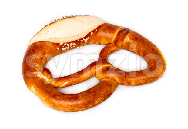 Closeup of traditional fresh German pretzel (Bretzel) with salt on white background