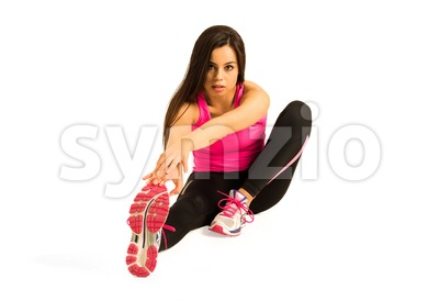 Young woman stretching her leg Stock Photo