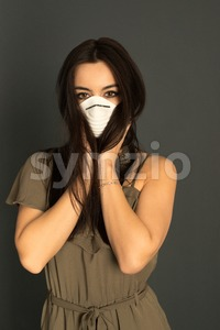 Attractive woman with protective mask Stock Photo