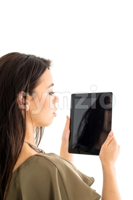 Attractive woman using a tablet computer Stock Photo
