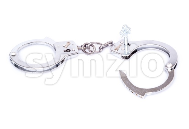 Steel handcuffs isolated on white background Stock Photo