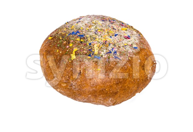 Large loaf of bread deliciously decorated with dried flowers isolated on white