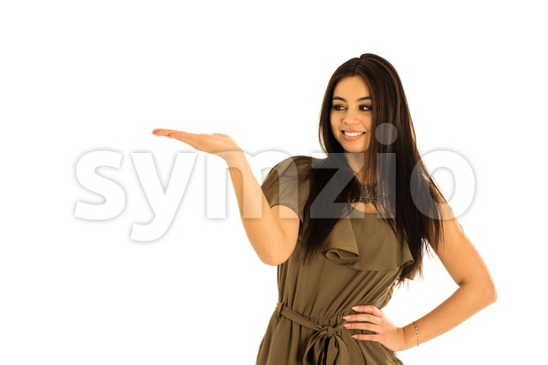 Attractive young woman, multi-racial Asian and Caucasian, looking at your product with great joy. Isolated on white background, your prodcut ...