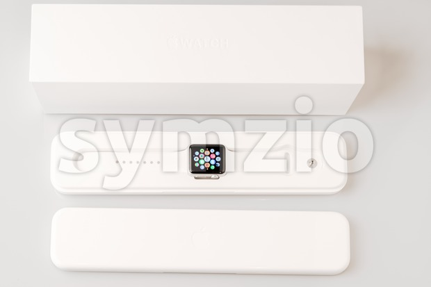 OSTFILDERN, GERMANY - APRIL 26, 2015: Unboxing the new Apple Watch: Outer box with inner plastic case carrying the actual ...