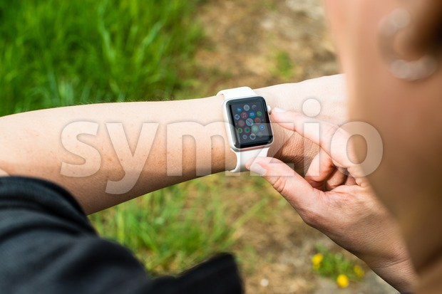 Woman checking her Apple Watch Stock Photo