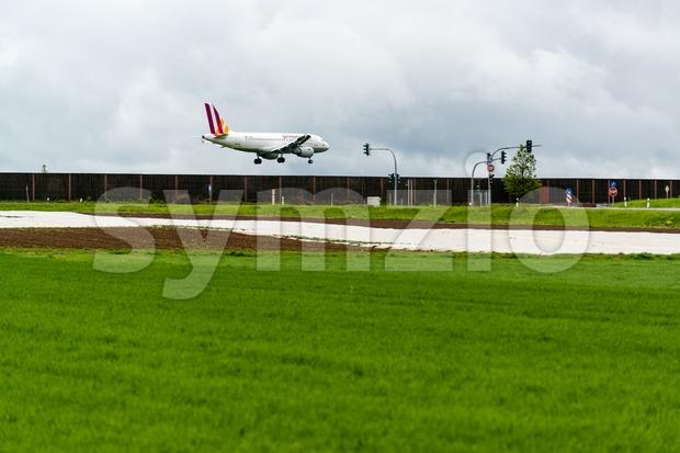 STUTTGART, GERMANY- MAY 03, 2015: A Germanwings Airbus A319-100 airplane is approaching Stuttgart Airport in Germany. Germanwings is a German ...
