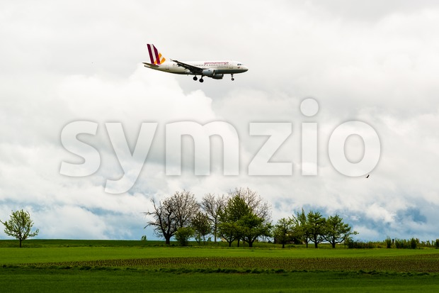 STUTTGART, GERMANY- MAY 03, 2015: A Germanwings Airbus A319-100 airplane is approaching Stuttgart Airport in Germany. Germanwings is a German ...