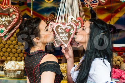 Young women with gingerbread hearts on Oktoberfest Stock Photo