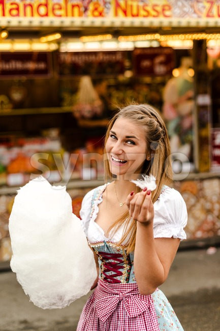Beautiful woman with cotton candy Stock Photo