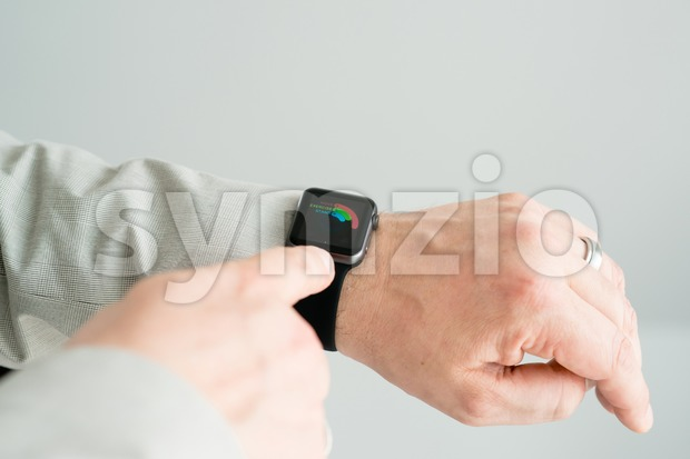 Businessman checking his daily activities using the Apple Watch Stock Photo