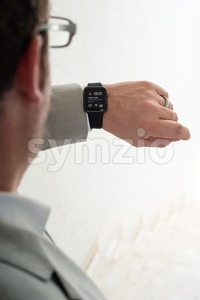 Businessman checking his Apple Watch Stock Photo