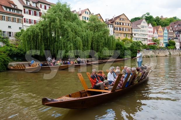 Tubingen, Germany - May 17,2015: A traditional punt is passing the beautiful waterfront of Tubingen (Tuebingen) in the south of ...