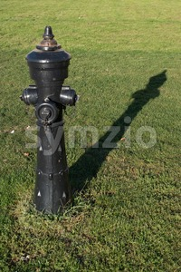 Old black fire hydrant Stock Photo