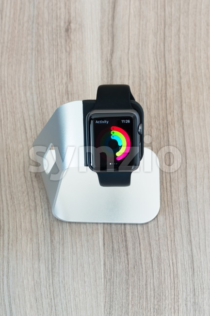 Apple watch in stand displaying mediocre daily activities Stock Photo