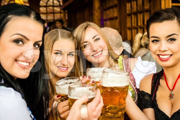 Girls drinking beer Stock Photo