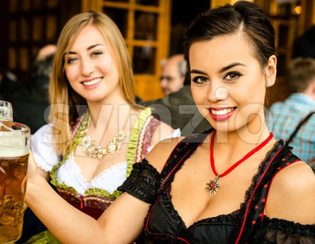 Girls drinking beer at Oktoberfest Stock Photo