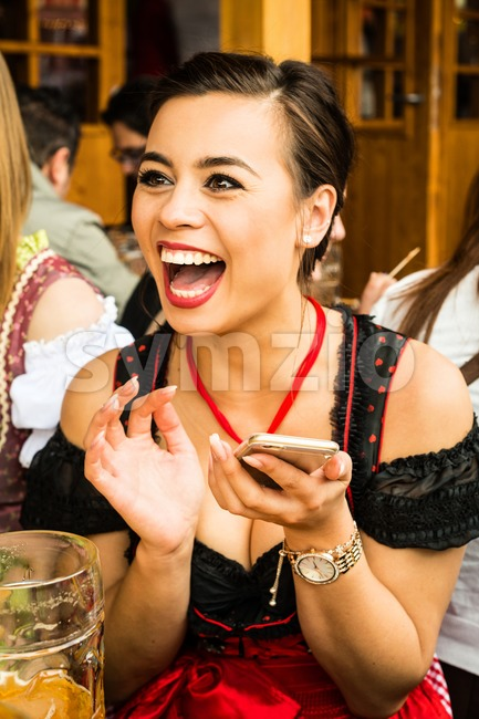 Girl drinking beer at Oktoberfest Stock Photo
