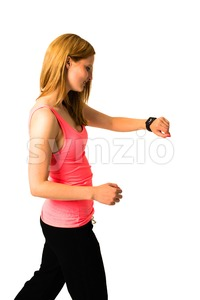 Woman checking her Apple Watch while jogging Stock Photo