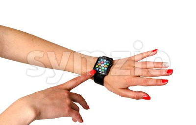 Woman touching icons on the Apple Watch Stock Photo