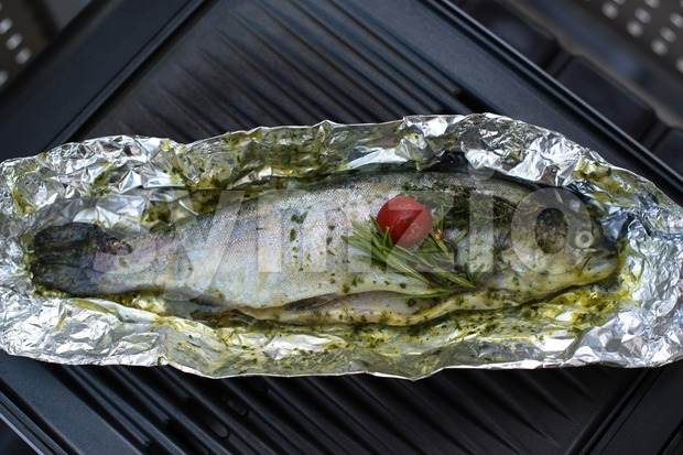 Grilled trout on barbecue Stock Photo