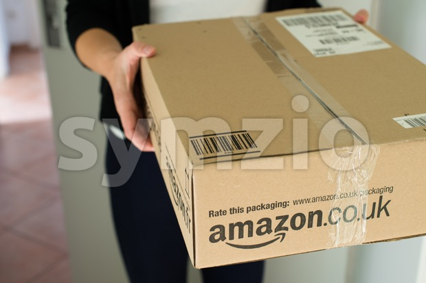 Woman receiving parcel Stock Photo