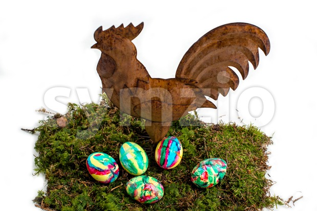 Easter Decoration: Painted Eggs and Rooster on Moss Stock Photo