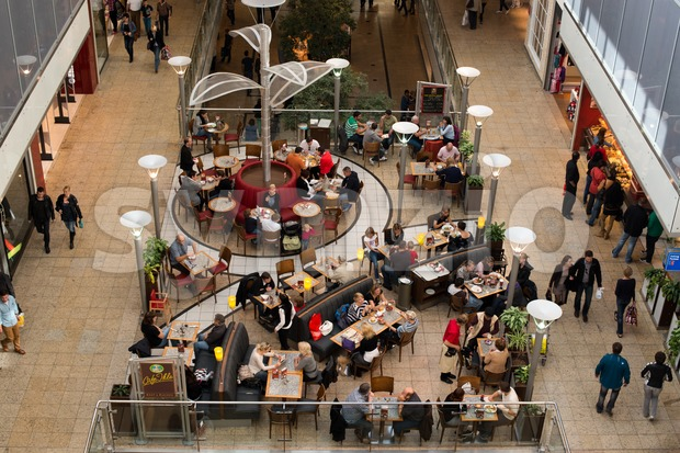 AUGSBURG – OCTOBER 20: People are shopping and resting in the City Galerie shopping mall on October 20,2012 in Augsburg, ...