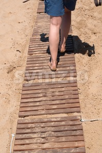 Walking on wooden boardwalk Stock Photo