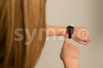 Woman touching the Apple Watch Stock Photo