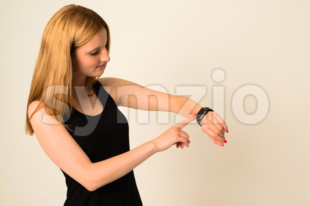 Young woman is touching the Apple Watch Stock Photo