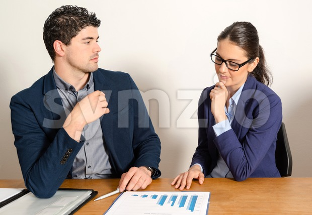 two young business people discussing Stock Photo