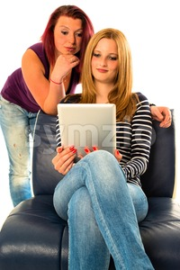 Two female friends looking at digital tablet Stock Photo