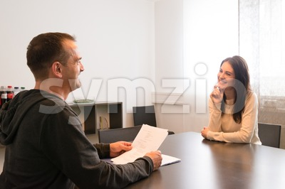 Young female candidate smiling very relaxed during job interview Stock Photo