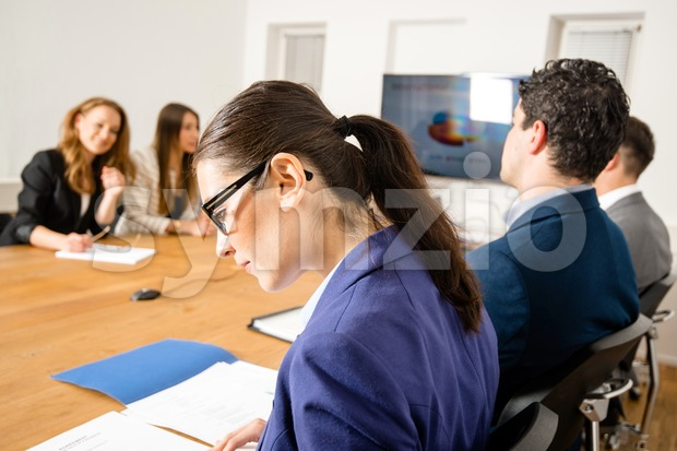 Checking facts during business meeting Stock Photo