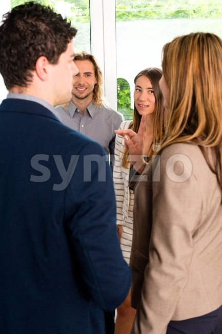 Businesspeople discussing in office Stock Photo